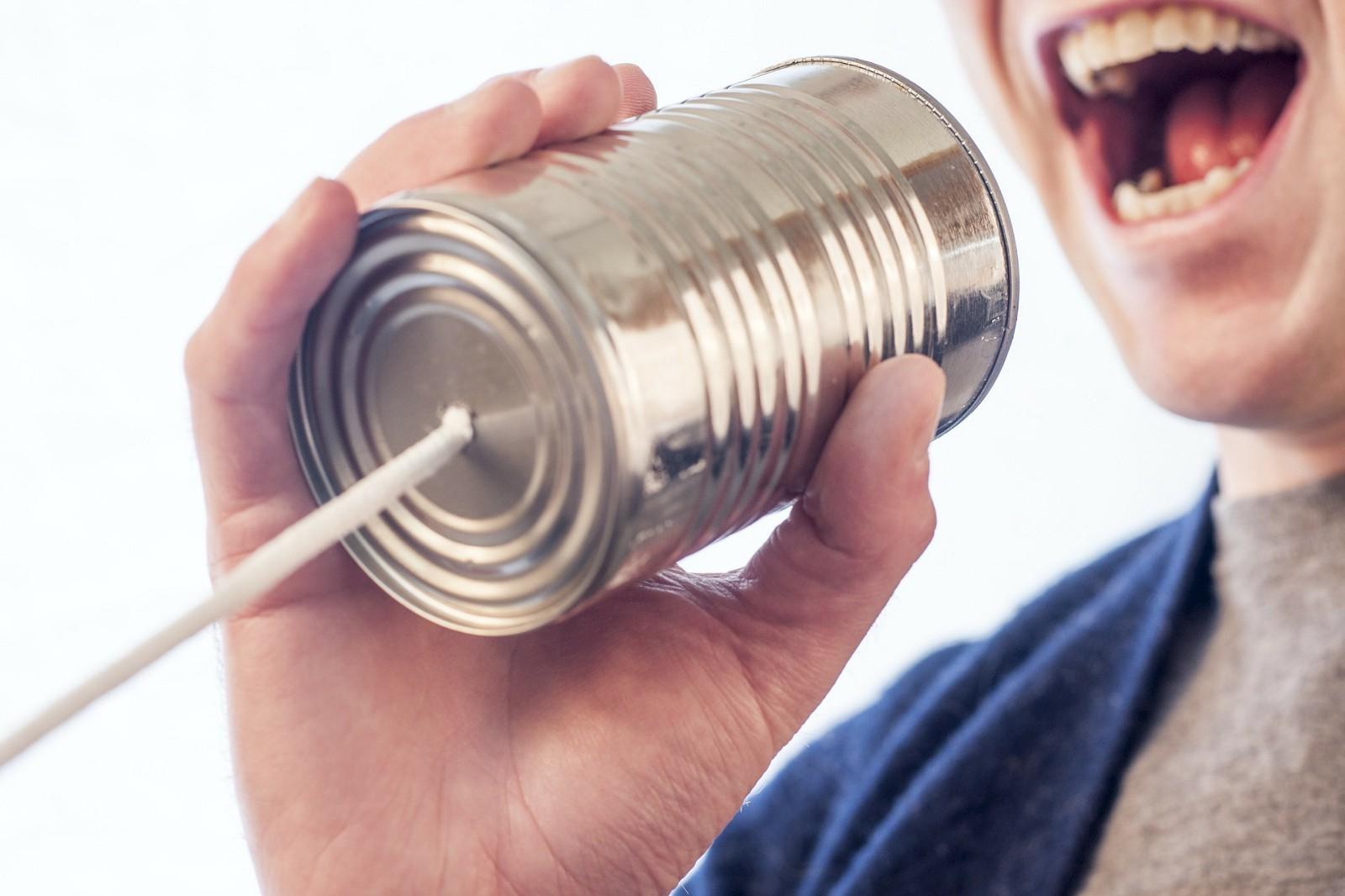 man speaking into metal can phone line, communication, public speaking, crosslead, washington dc