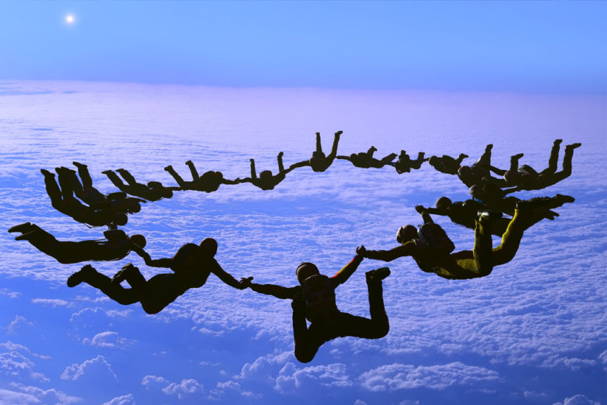 group of people skydiving at sunset, crosslead, leadership development, washington dc